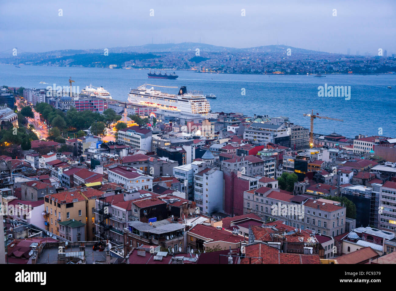 Bosphorus Strait and cruise ship at night seen from Galata Tower, Istanbul, Turkey, Europe - Stock Image