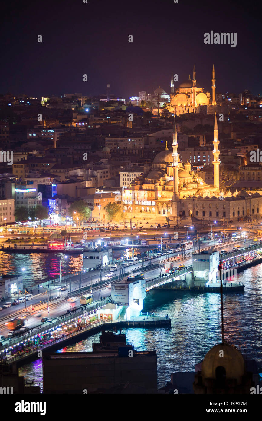 New Mosque (Yeni Cami) and Galata Bridge across Golden Horn at night seen from Galata Tower, Istanbul, Turkey, Europe - Stock Image