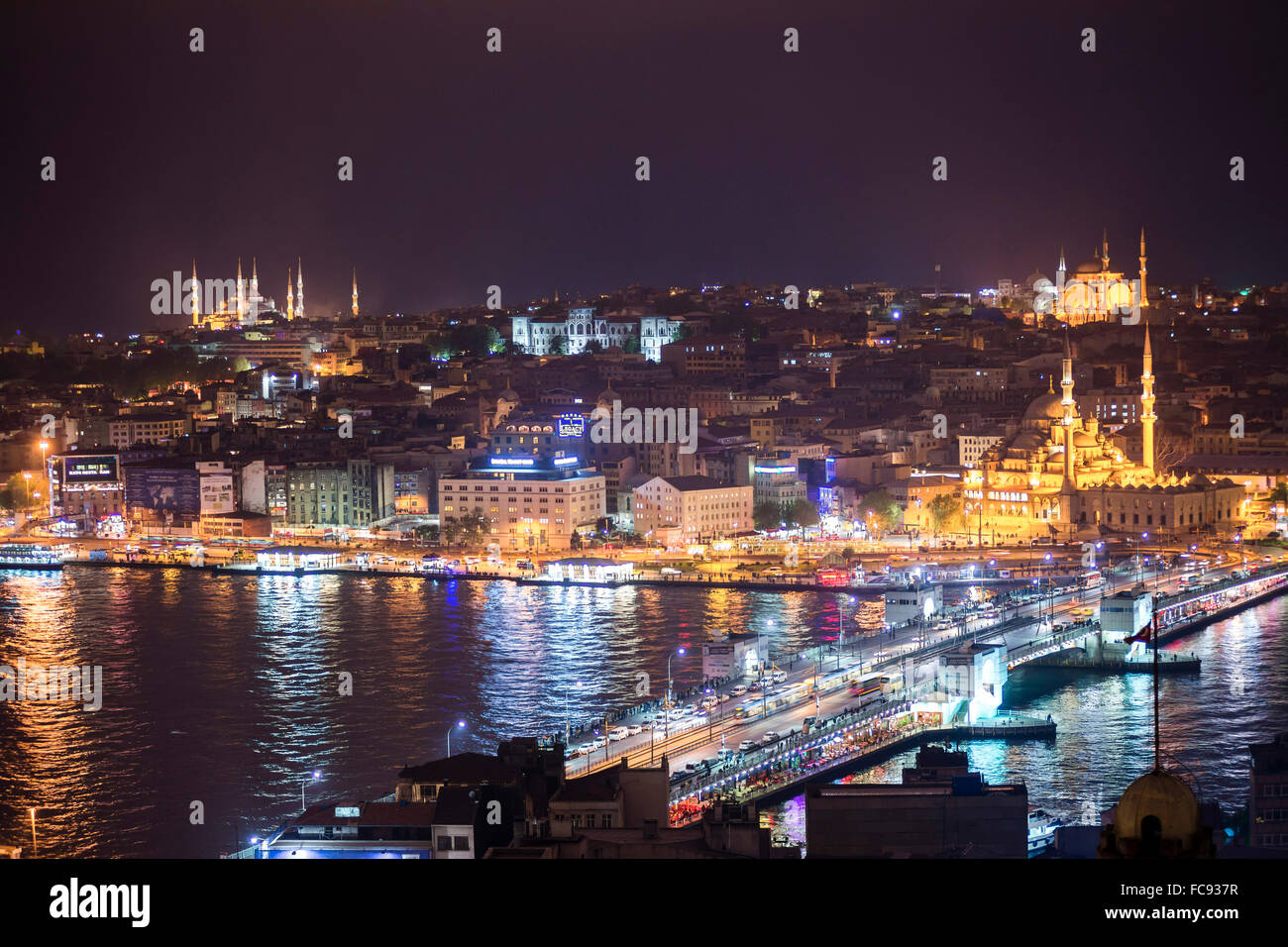 Istanbul at night, with Blue Mosque on left, New Mosque on right and Galata Bridge across Golden Horn, Turkey, Europe - Stock Image