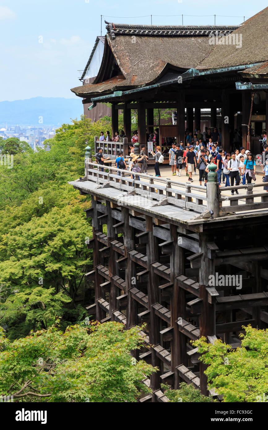 Main hall, busy hillside veranda with huge wooden pillars, Kiyomizu-dera, temple in summer, Southern Higashiyama, - Stock Image