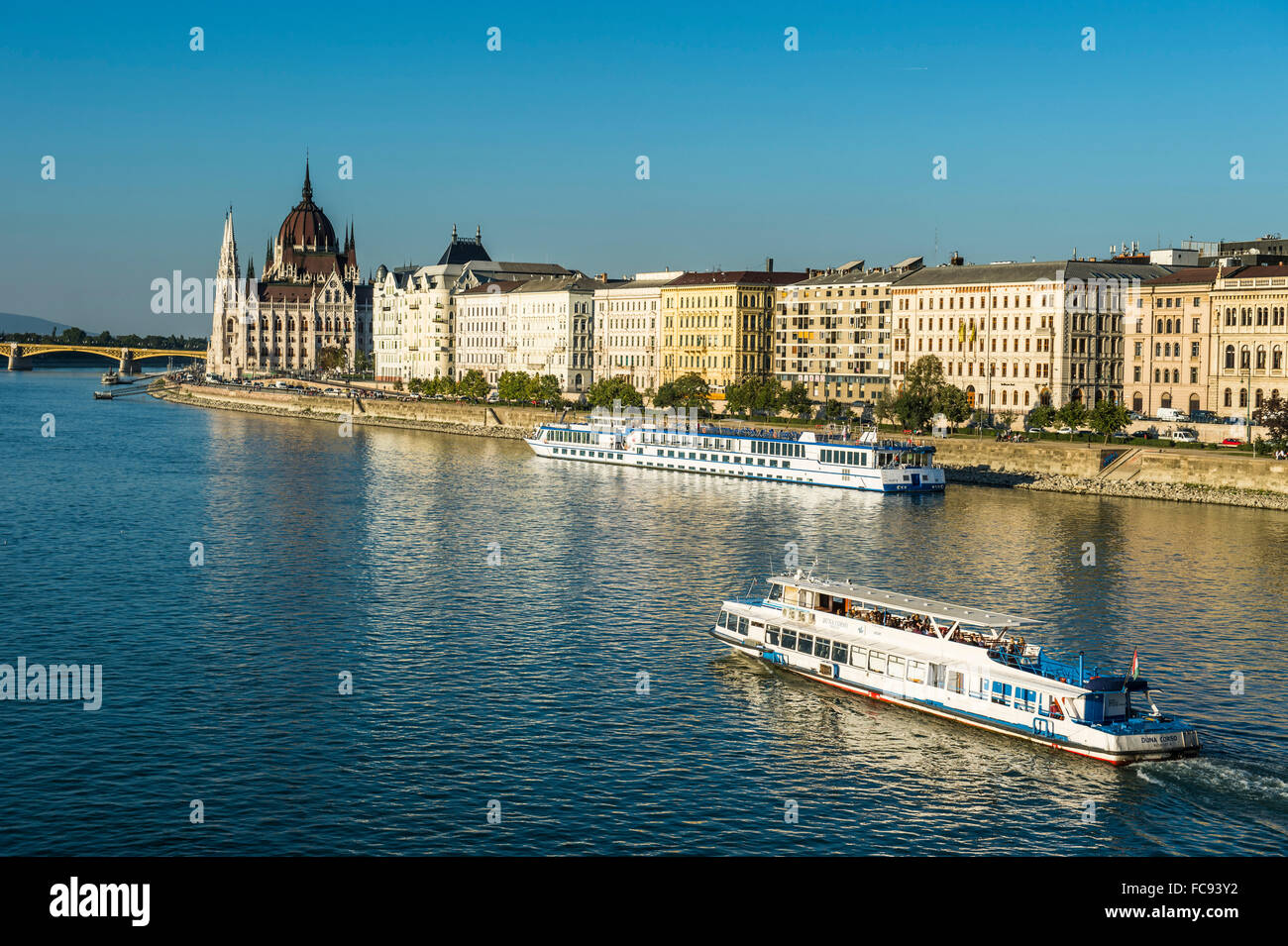 Little ferries on the River Danube in front of the Panorama of Pest, Budapest, Hungary, Europe - Stock Image