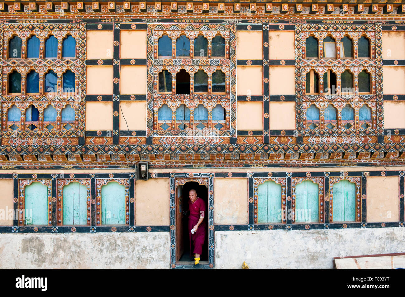 Monk leaving his house, Paro, Bhutan, Asia - Stock Image