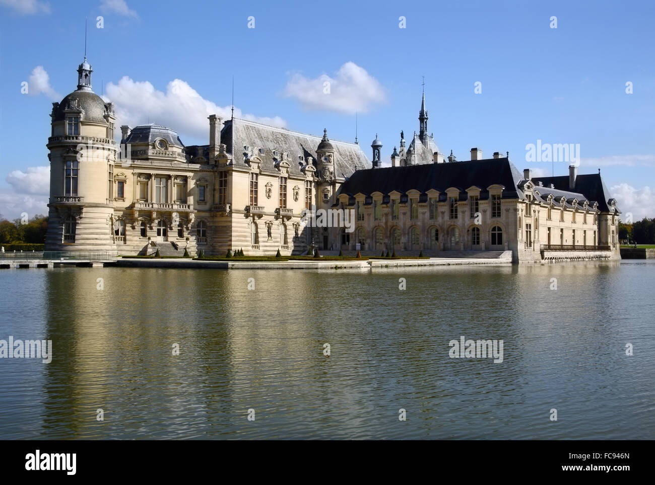 Chateau Chantilly across the moat, Chantilly, Oise, France, Europe - Stock Image
