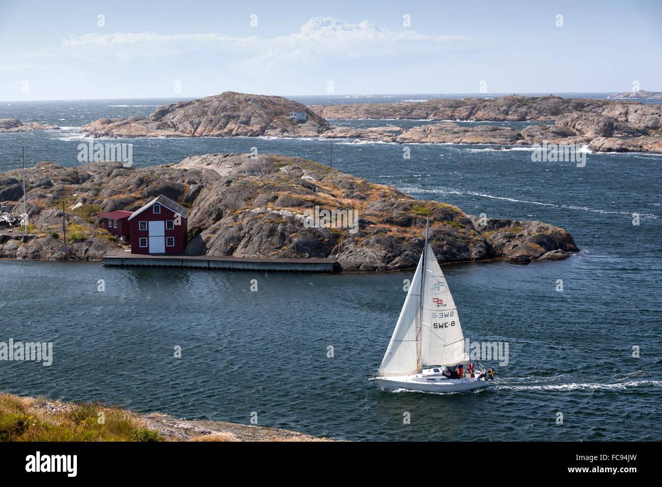 Yacht sailing through islands of archipelago, Skarhamn, Tjorn, Bohuslan Coast, southwest Sweden, Sweden, Scandinavia, - Stock Image