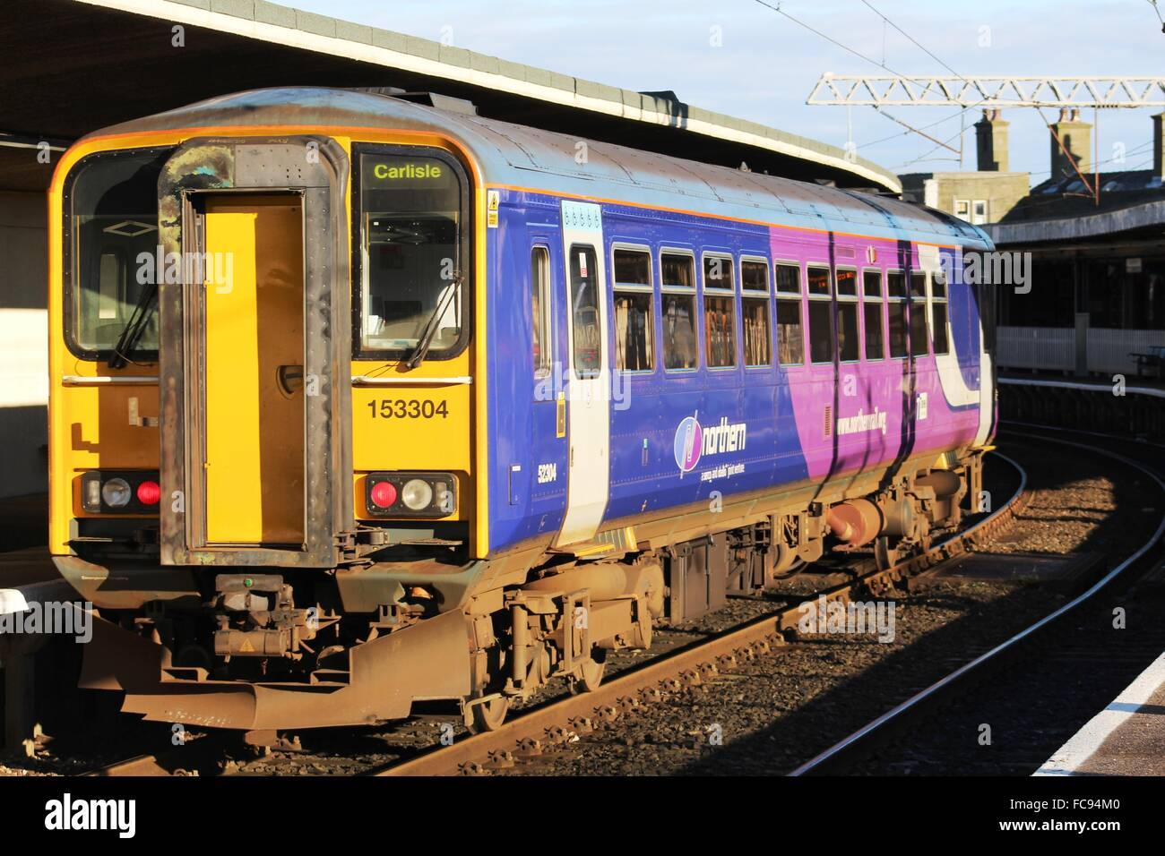 Class 153 diesel unit in Northern livery arriving at Carnforth railway station with a service from Lancaster to - Stock Image