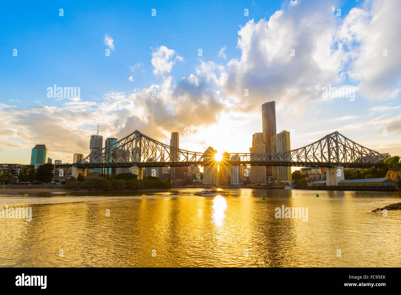 Sunset, Brisbane city with the sun hidden behind the Story Bridge, Brisbane, Queensland, Australia, Pacific - Stock Image