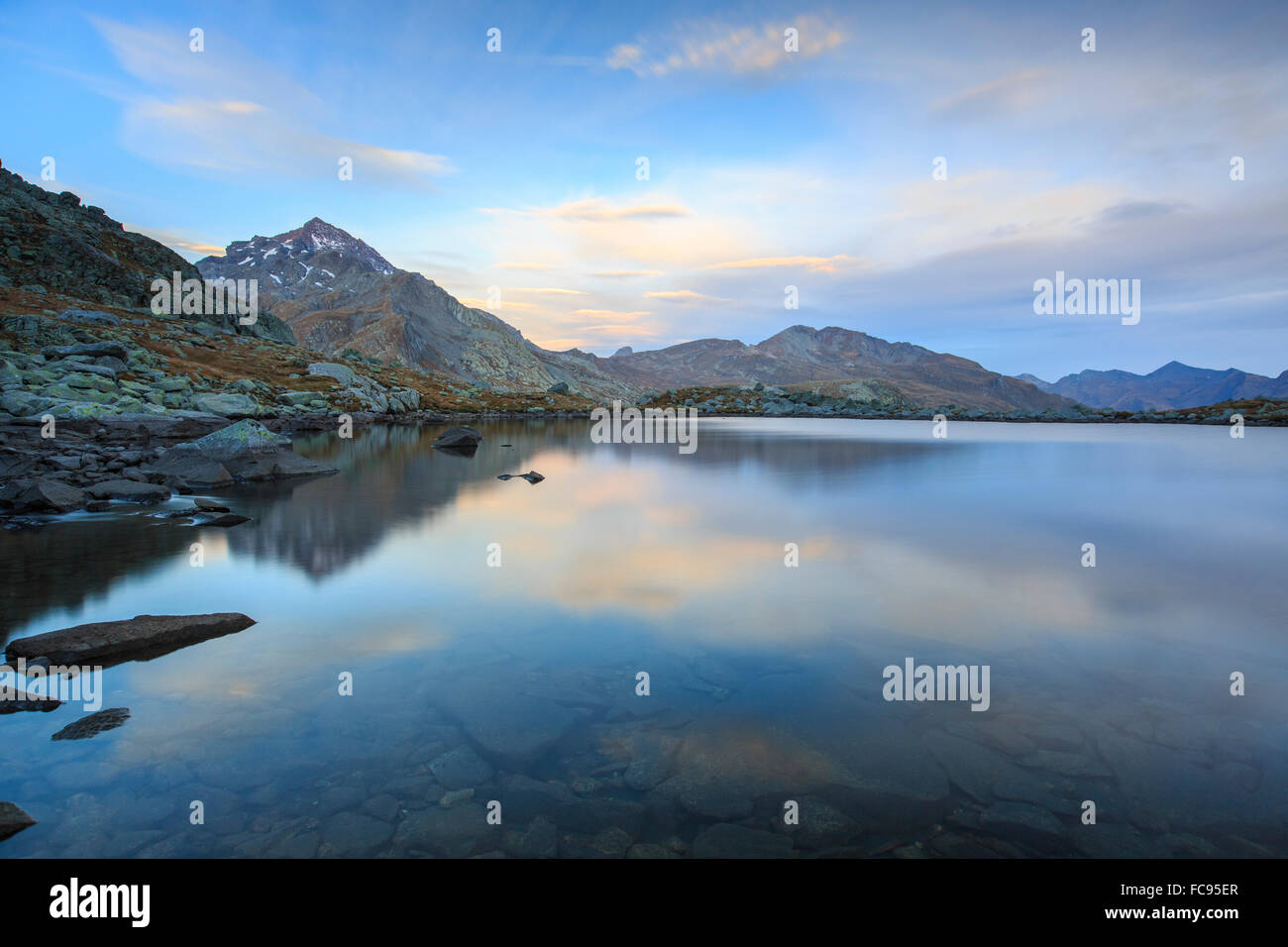 Peak Tambo reflected in Lake Bergsee at dawn, Chiavenna Valley, Spluga Valley, Switzerland, Europe - Stock Image