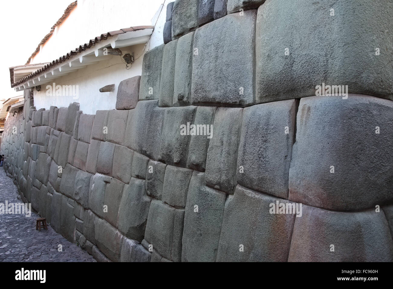 Wall of house made up of part Inca craftmanship and part Spanish workmanship, Cuzco, Peru, South America - Stock Image