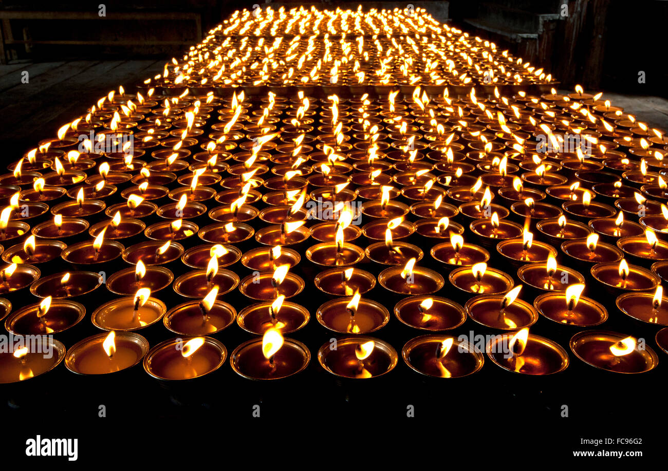 Butter lamps lit in Mongar Dzong (monastery), one of Bhutan's newest dzongs, built without plans or nails, Bhutan - Stock Image