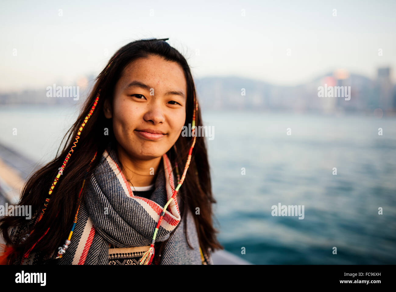 Portrait of young woman, Avenue of Stars, Tsim Sha Tsui Waterfront, Kowloon, Hong Kong, China, Asia - Stock Image