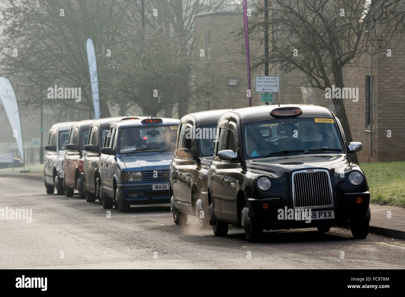 A line of taxis at Warwick University, UK - Stock Image
