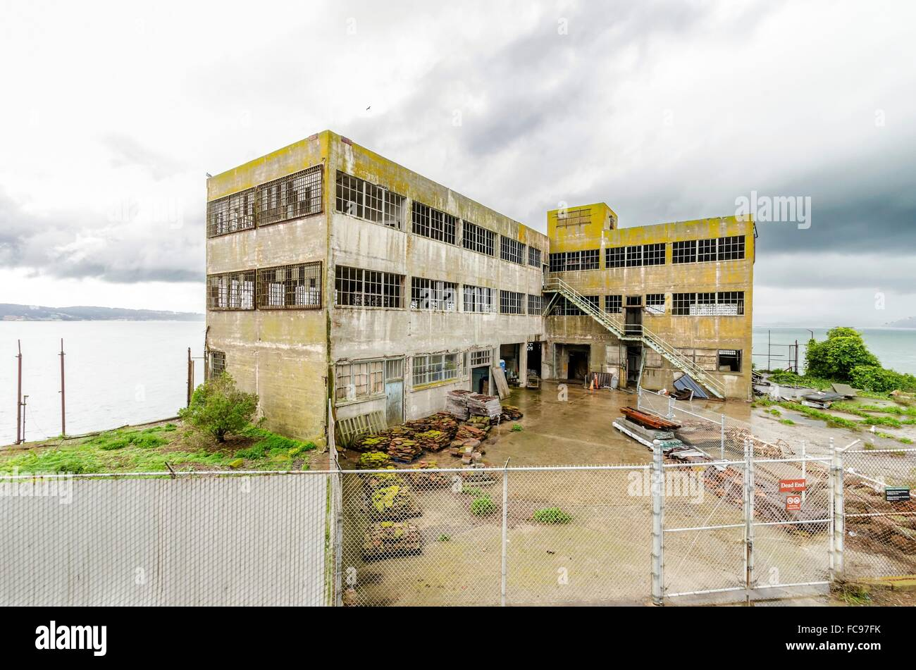 Model Industries Building on Alcatraz Penitentiary in San Francisco, California. An old, moldy, haunting building, - Stock Image
