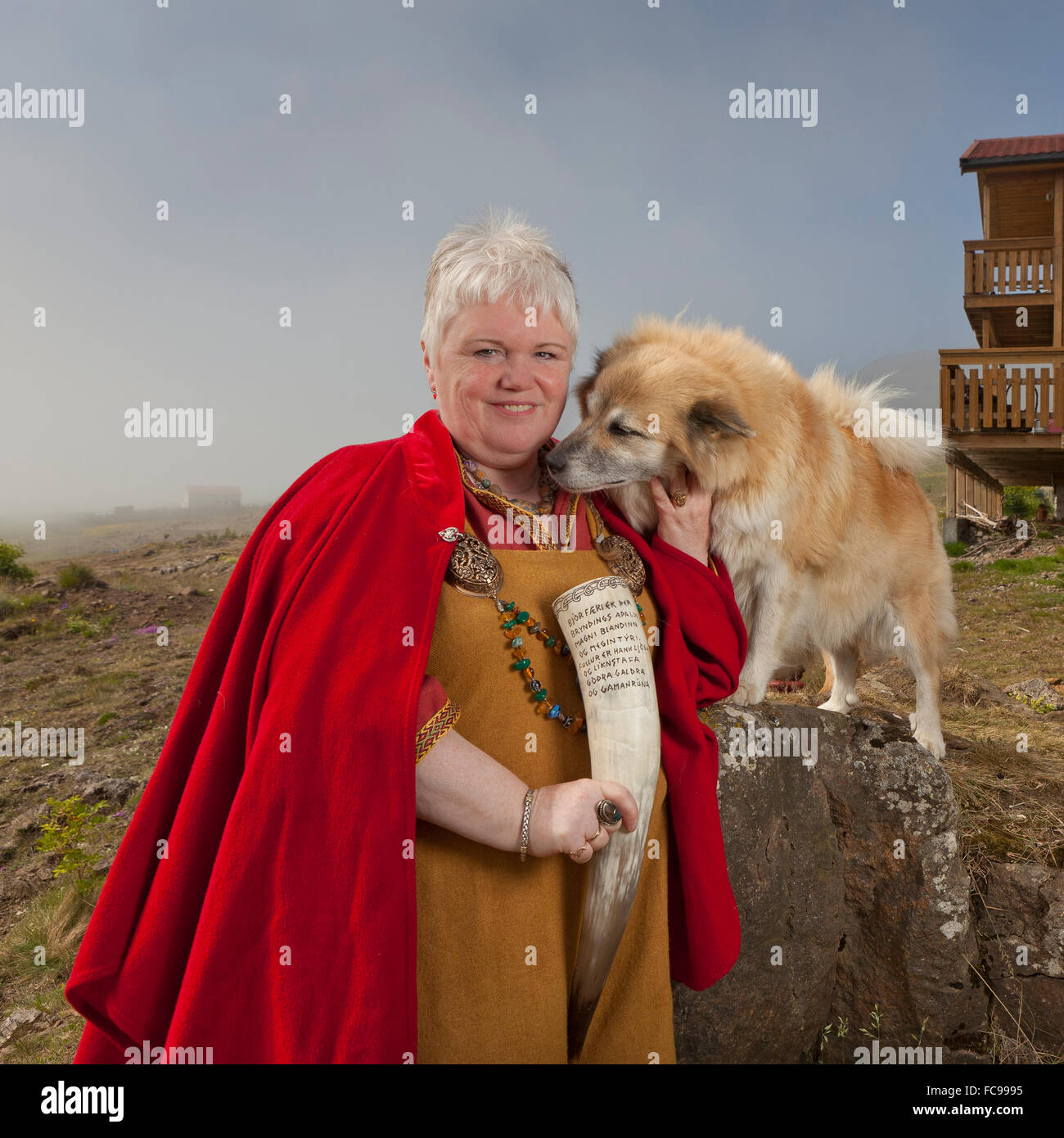 Asa Priest in traditional viking clothing, holding a bull horn. Asa beliefs also know as Paganism. - Stock Image