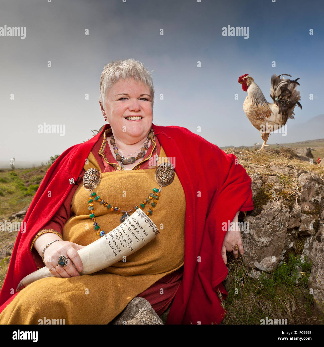 Asa Priest in traditional viking clothing, holding a bull horn. Asa beliefs also know as Paganism. Stock Photo
