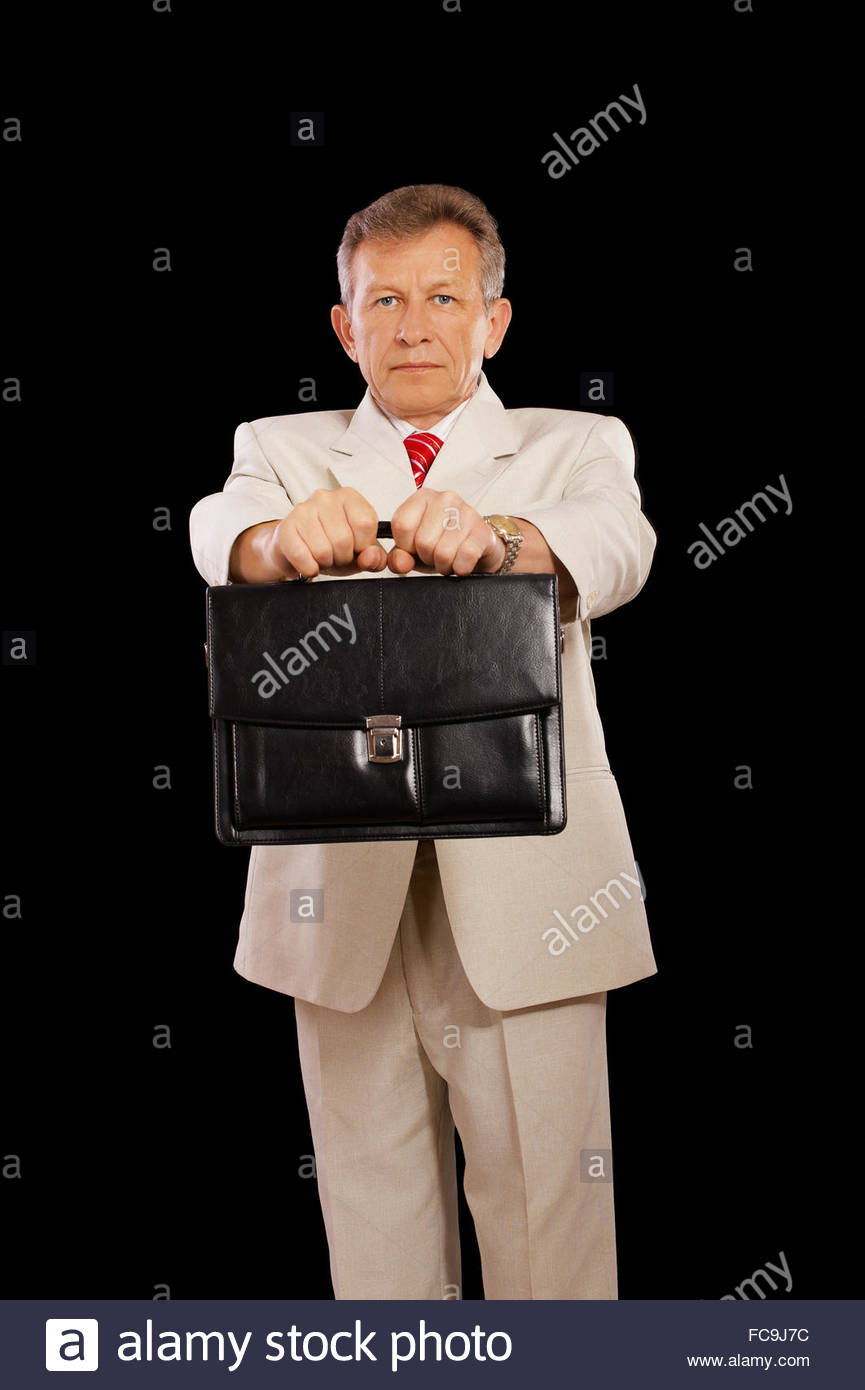 older businessman with attache - Stock Image