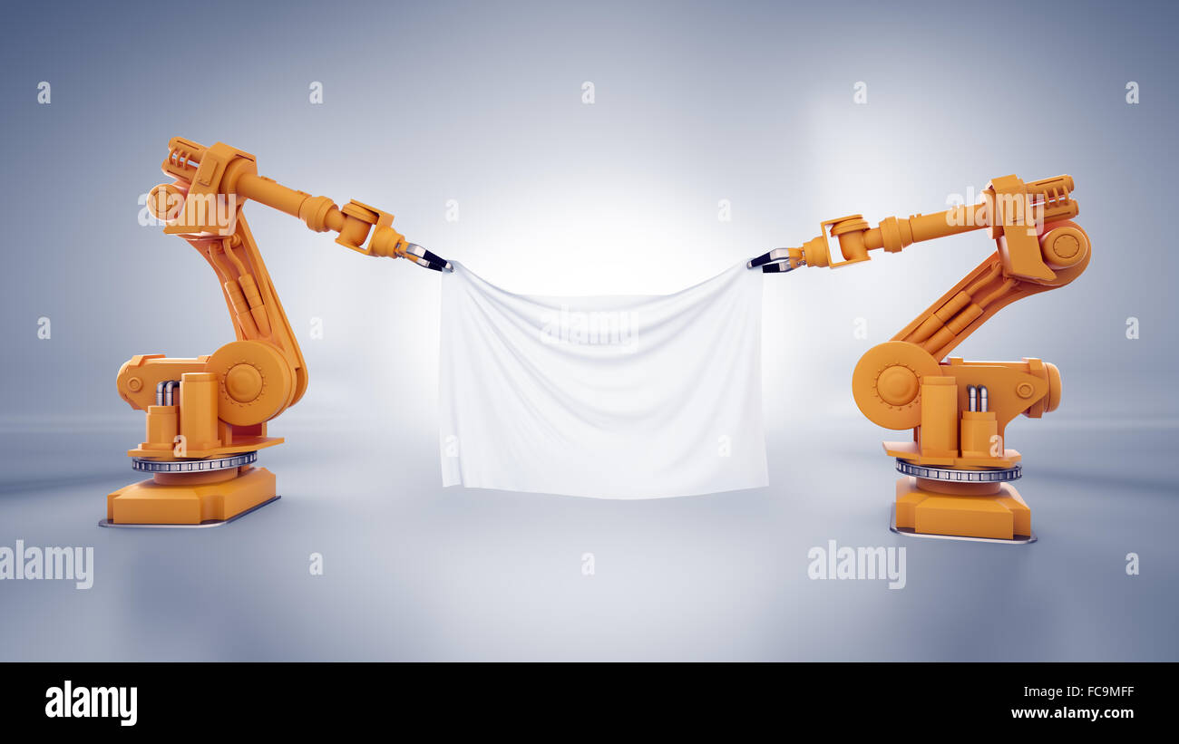 Two industrial robots holding a banner made out of a piece of fabric - Stock Image