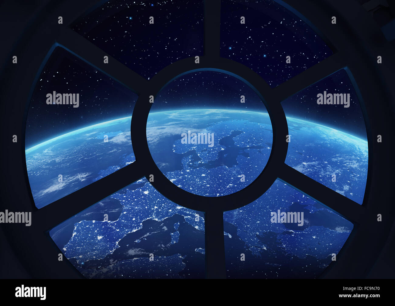 A round window on a space station with a view of Earth below - Stock Image