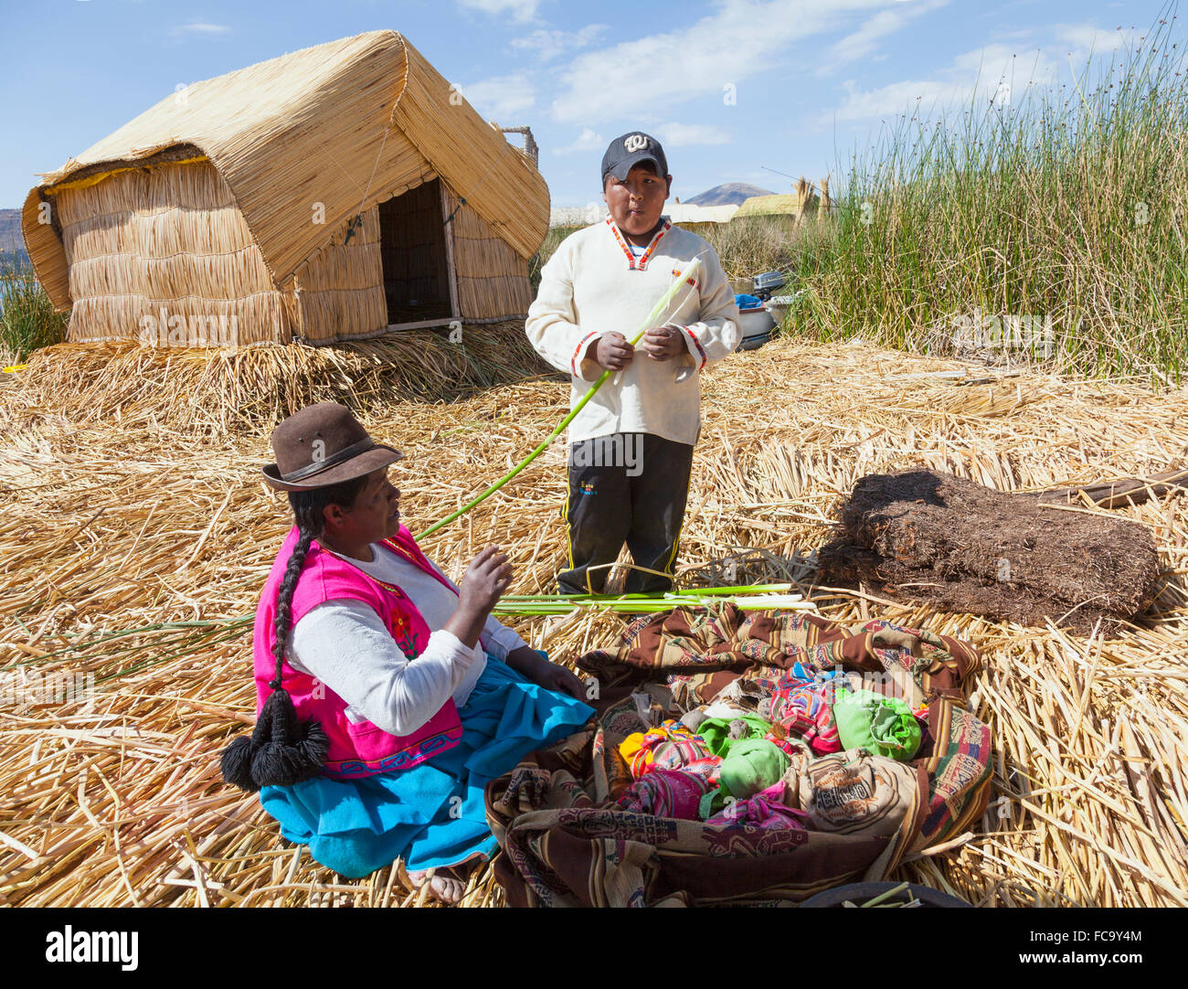 Mother and son - Uros Islands - Stock Image