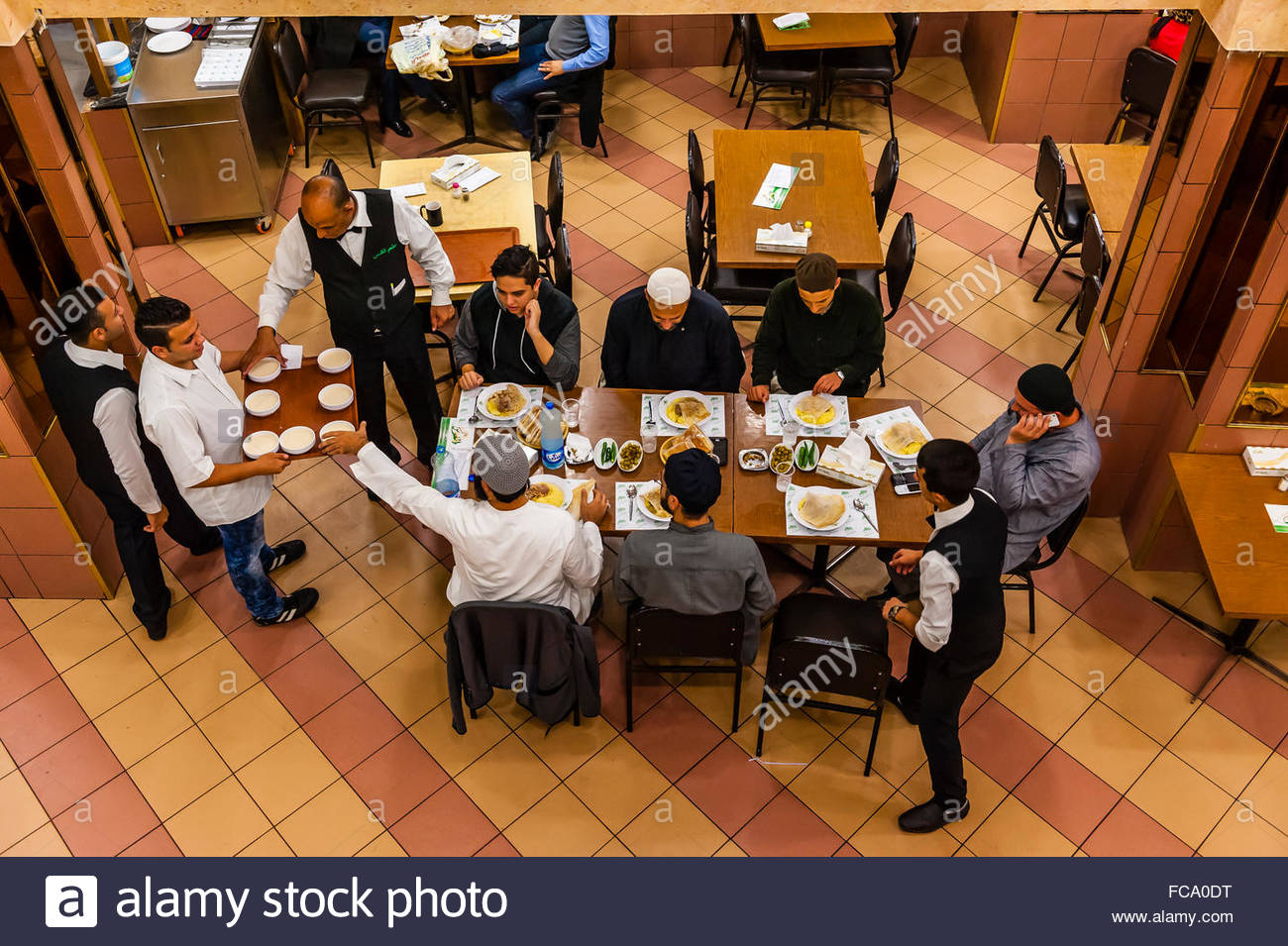 Overview, Men eating lunch, Al-Quds Restaurant, Downtown Amman, Jordan. - Stock Image