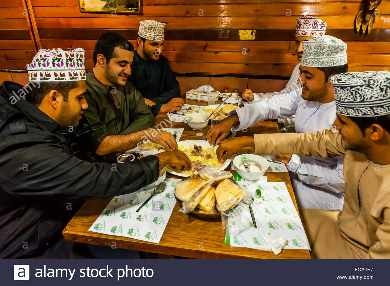 Omani men eating mansaf (the national dish of Jordan), Al-Quds Restaurant, Downtown Amman, Jordan. - Stock Image