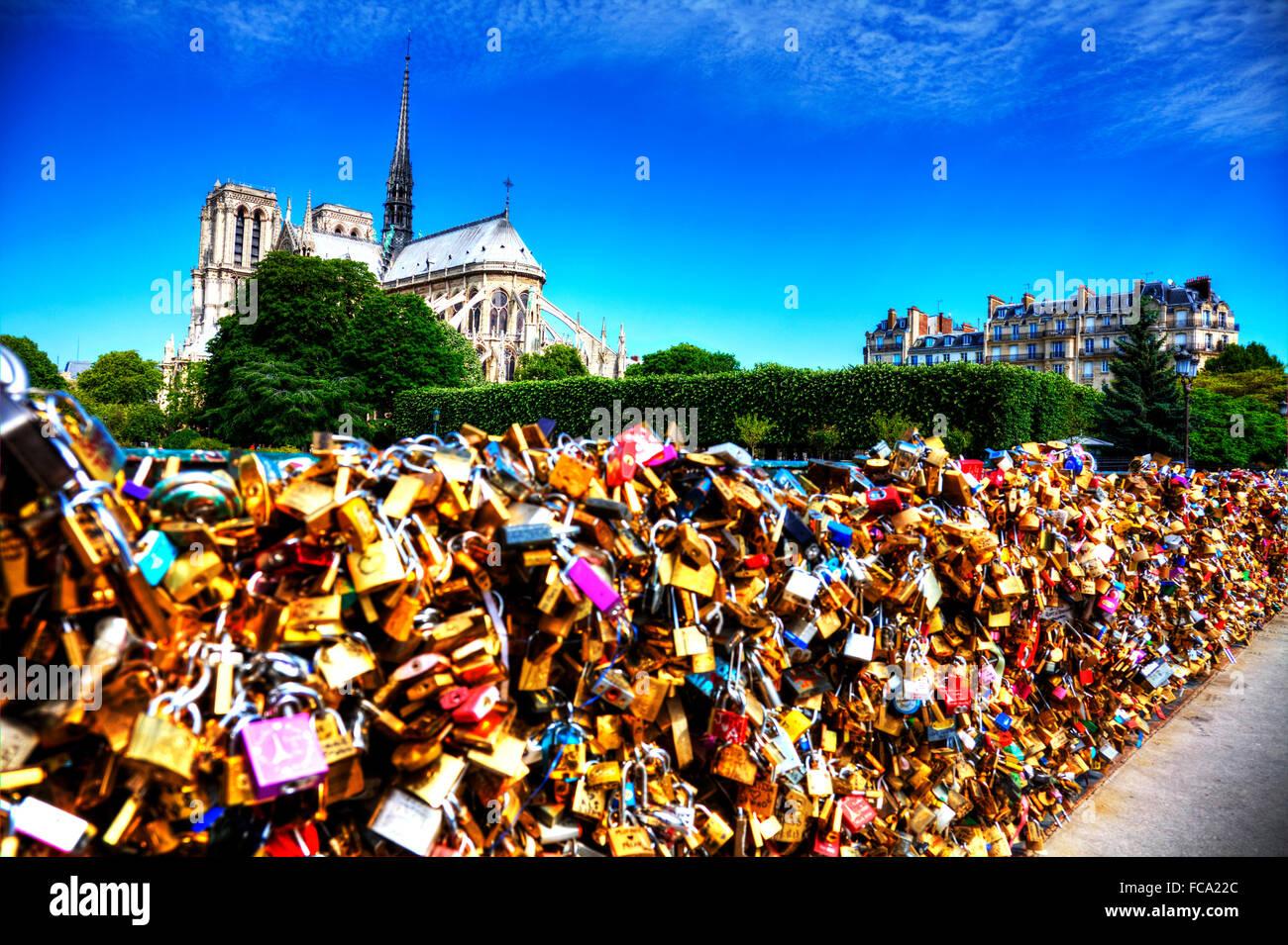 Notre Dame de Paris cathedral Pont de l'Archevêché L'Archeveche love locks padlocks bridge Paris - Stock Image