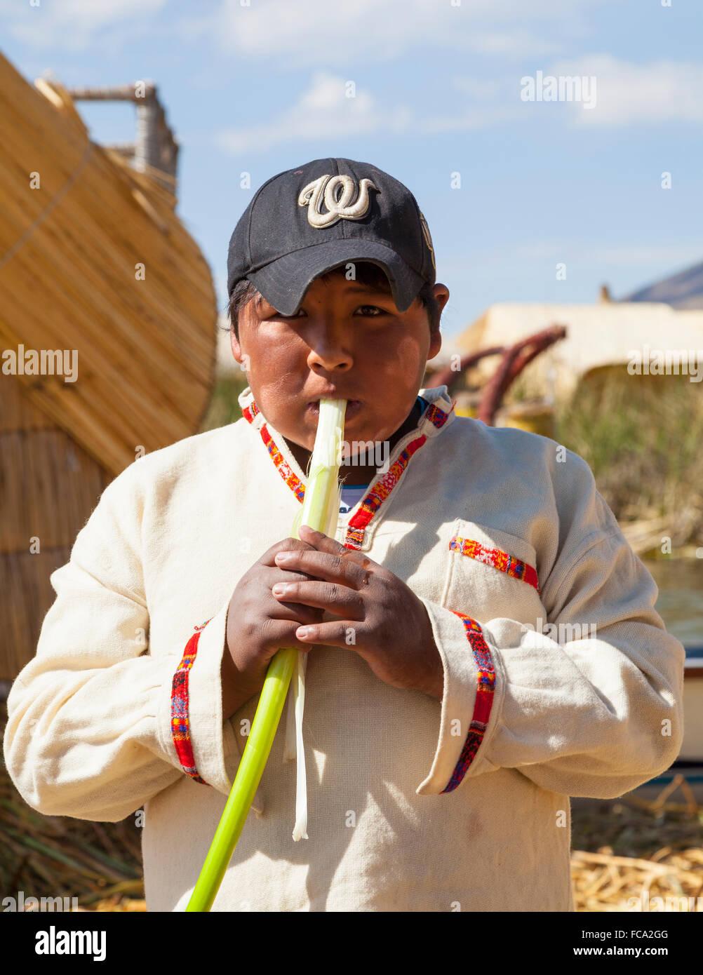 Uros Indian Boy, Uros floating Islands, Peru - Stock Image