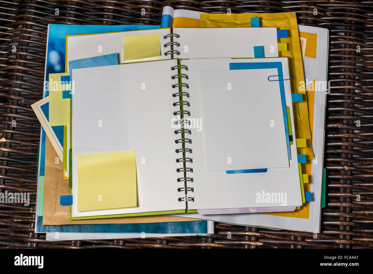 Getting organised and making notes in notebook - Stock Image