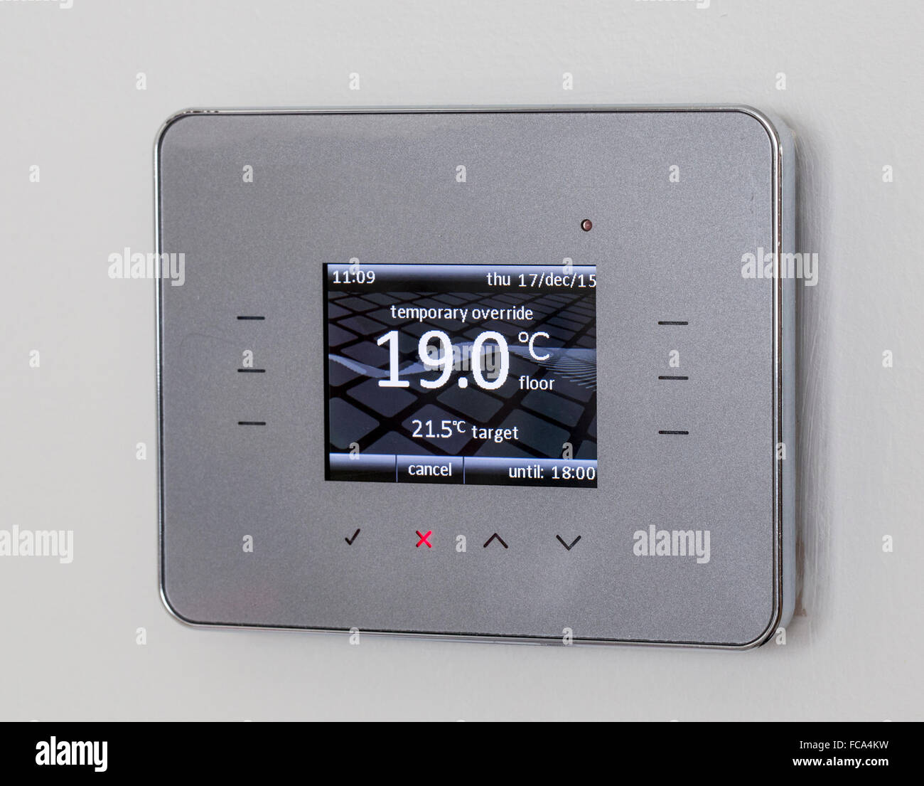 Temperature control unit for under floor heating system. - Stock Image