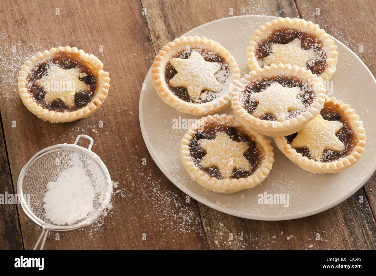 Delicious Christmas mince pies with stars - Stock Image
