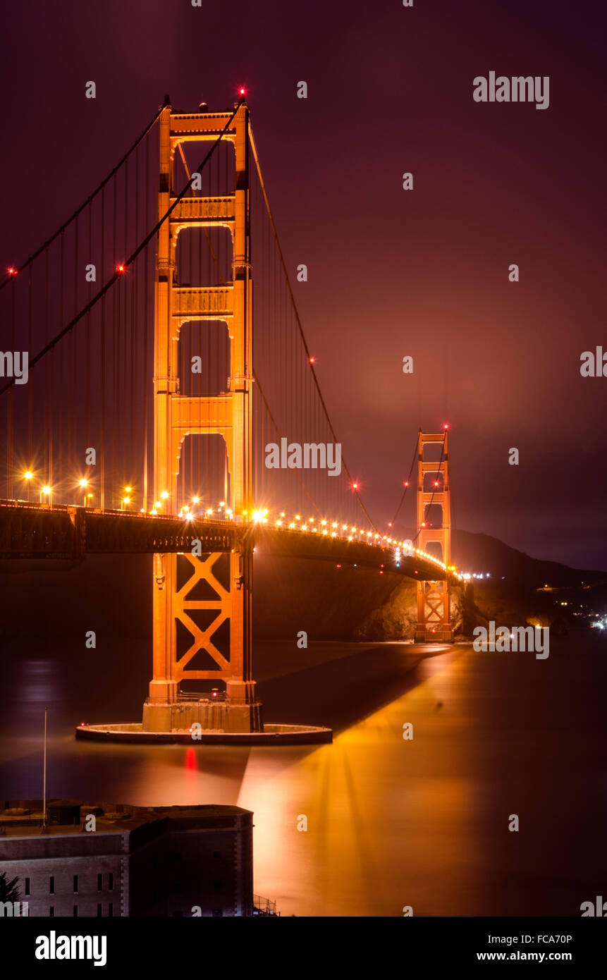 The famous San Francisco Golden Gate Bridge in California, United States of America. A long exposure of Fort Point, - Stock Image