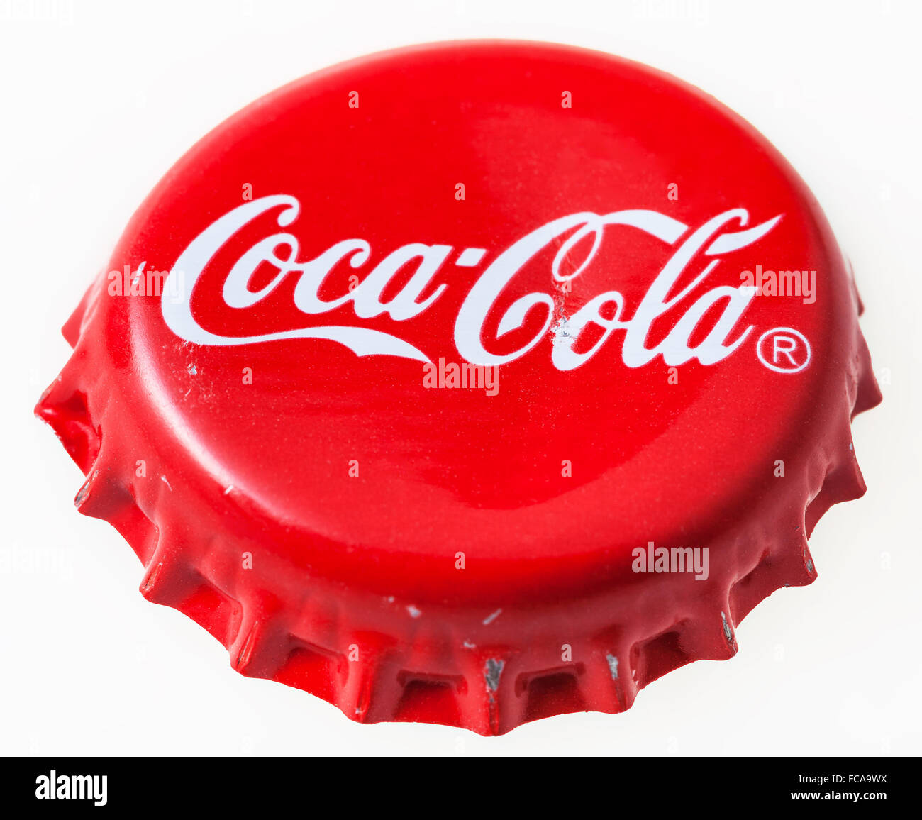 MOSCOW, RUSSIA - DECEMBER 12, 2105: Used red crown cap from the bottle of Coca-Cola soft drink. The Coca-Cola Company - Stock Image
