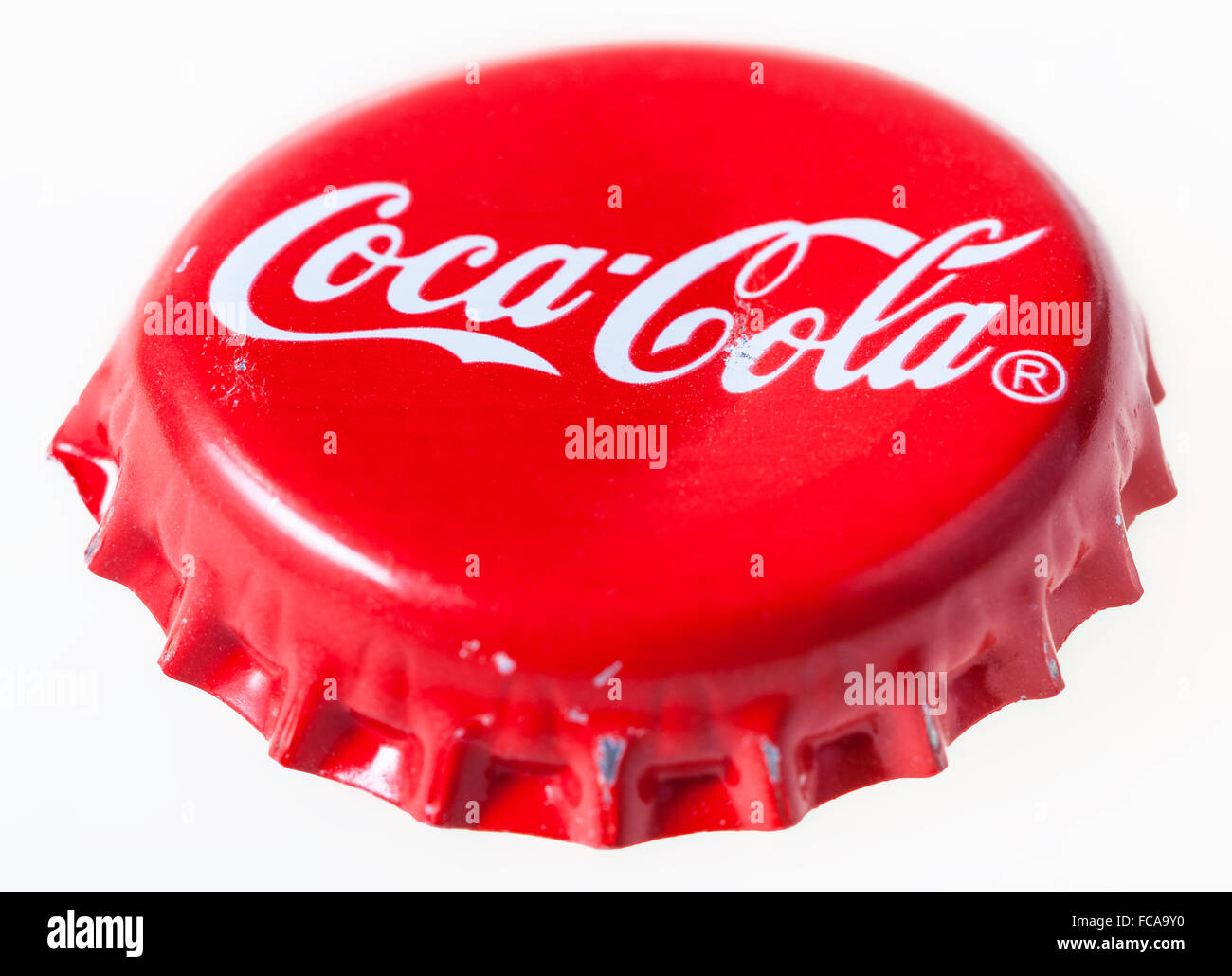 MOSCOW, RUSSIA - DECEMBER 12, 2105: Used red crown cork cap from the glass bottle of Coca-Cola. The Coca-Cola Company Stock Photo
