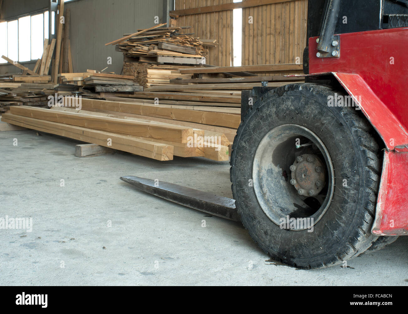 Carpentry factory and ordered timber - Stock Image