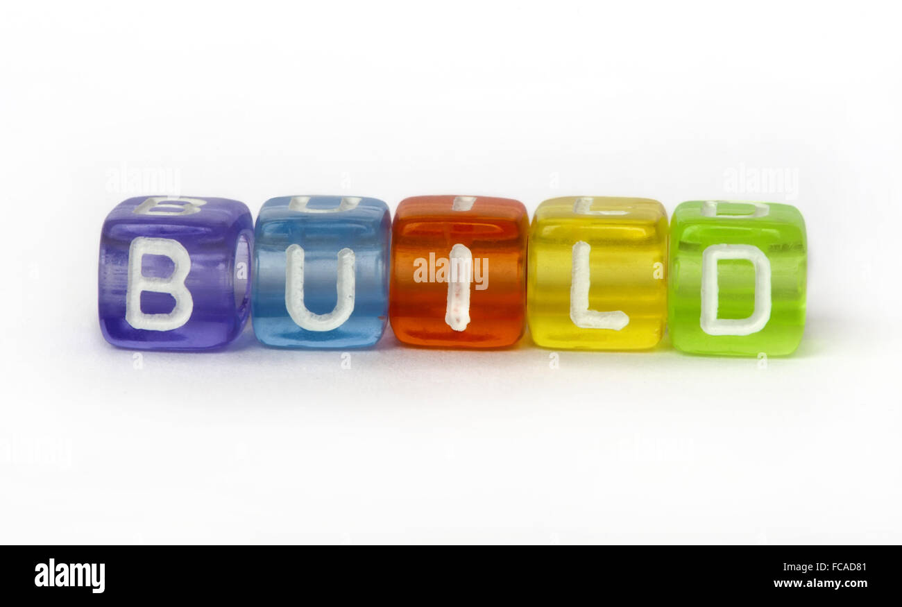 Text build on colorful wooden cubes - Stock Image