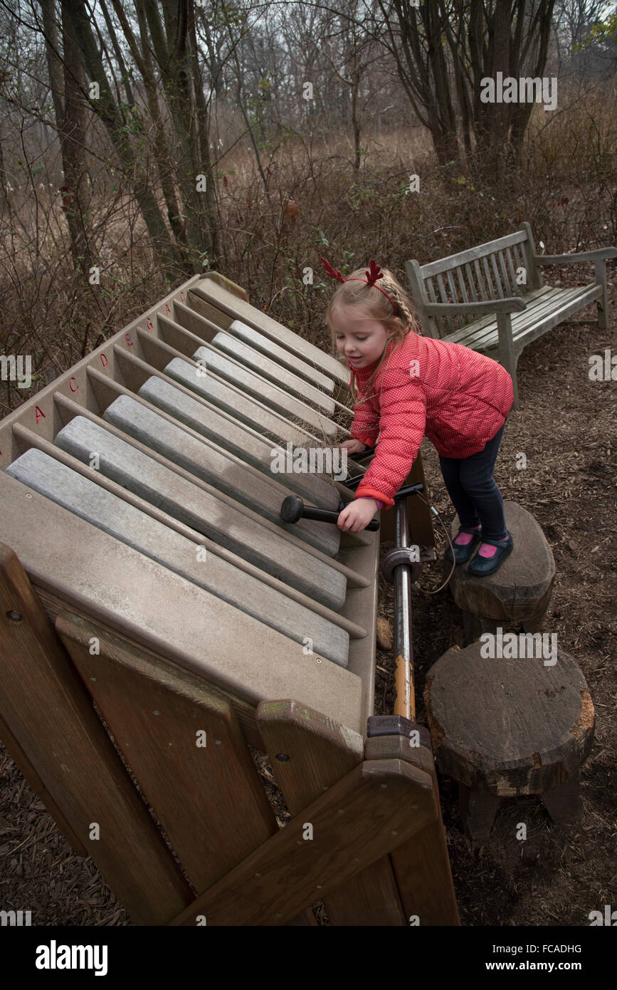A Child Playing A Xylophone While Visiting The Everett Childrenu0027s Adventure  Garden Within The New York Botanic Gardens NYC USA