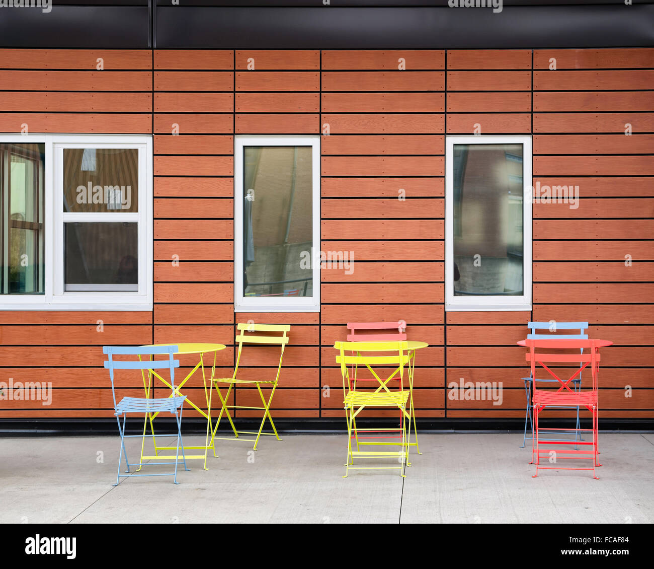 Colorful chairs and tables at Bailey Park. Winston Salem, NC - Stock Image