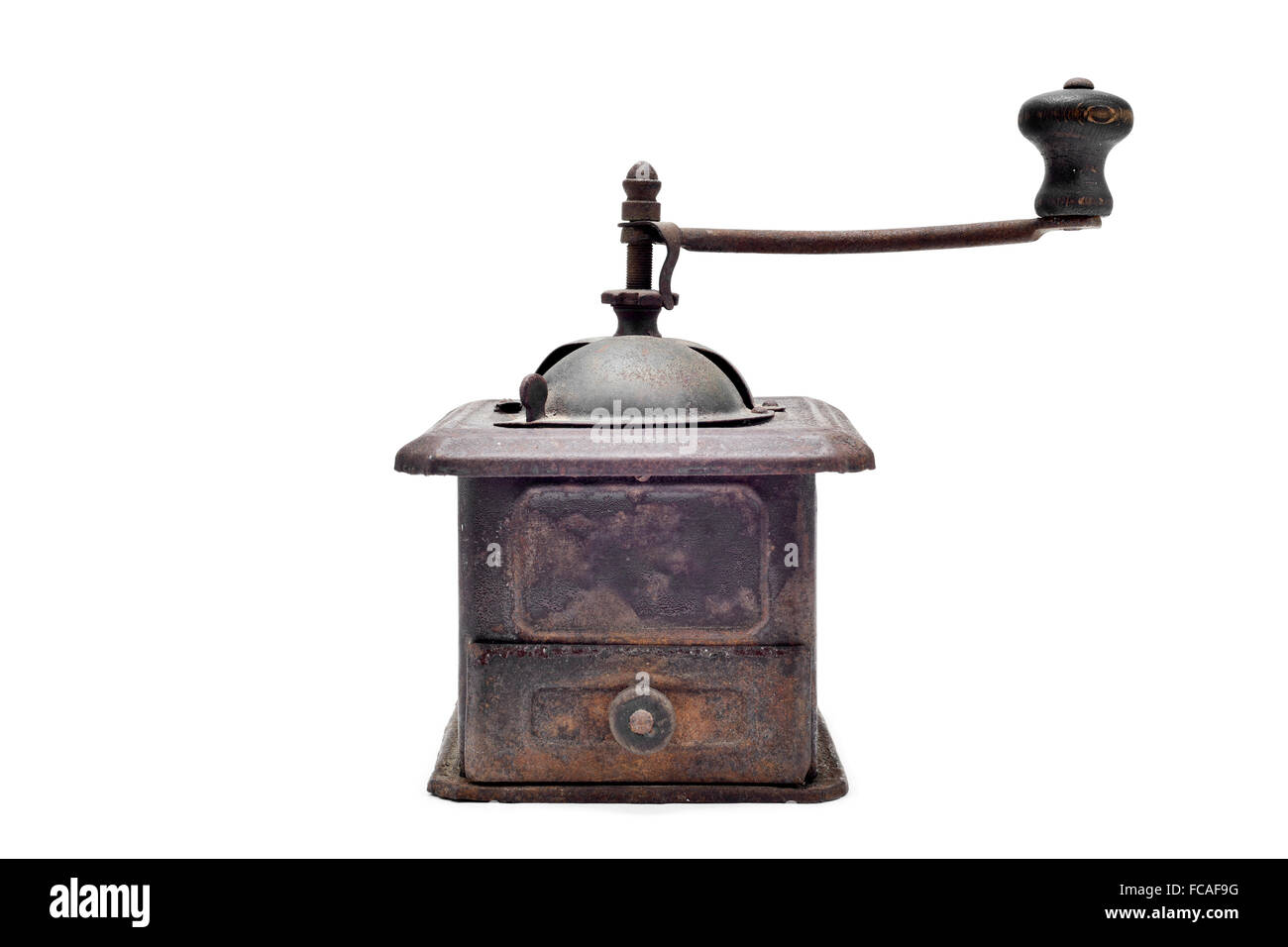 an old and rusty manual burr-mill coffee grinder on a white background - Stock Image