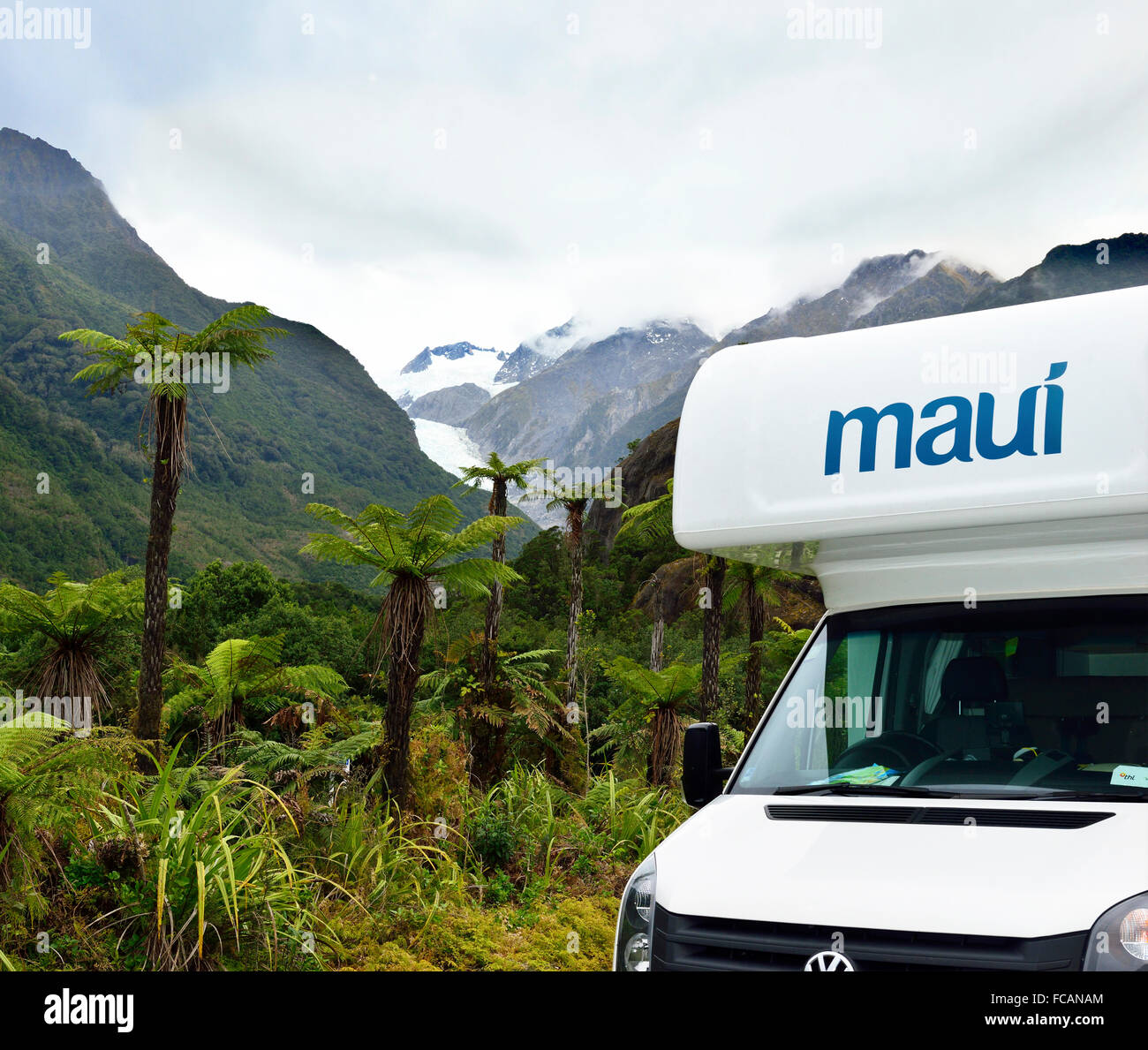 Maui Patinum Beach motorhome  in the Westland Tai Poutini National Park with Franz Josef Glacier in the background - Stock Image