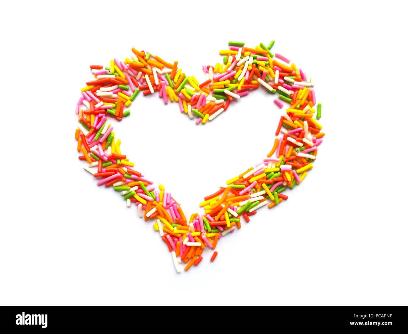 Valentine sweet sprinkle heart on white background - Stock Image