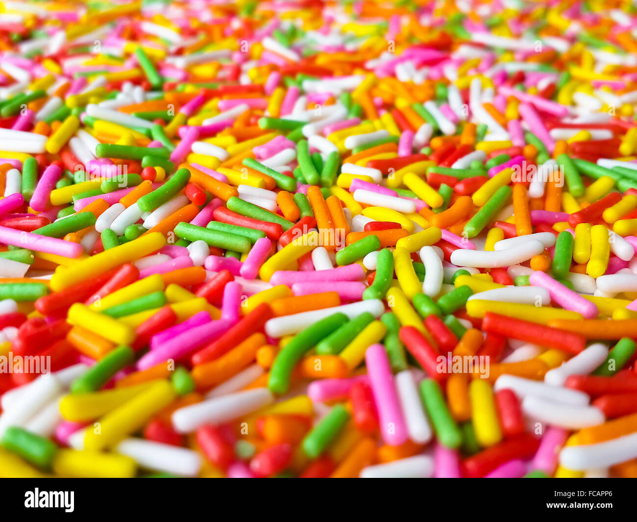 Colorful sprinkle background, Narrow depth of field - Stock Image