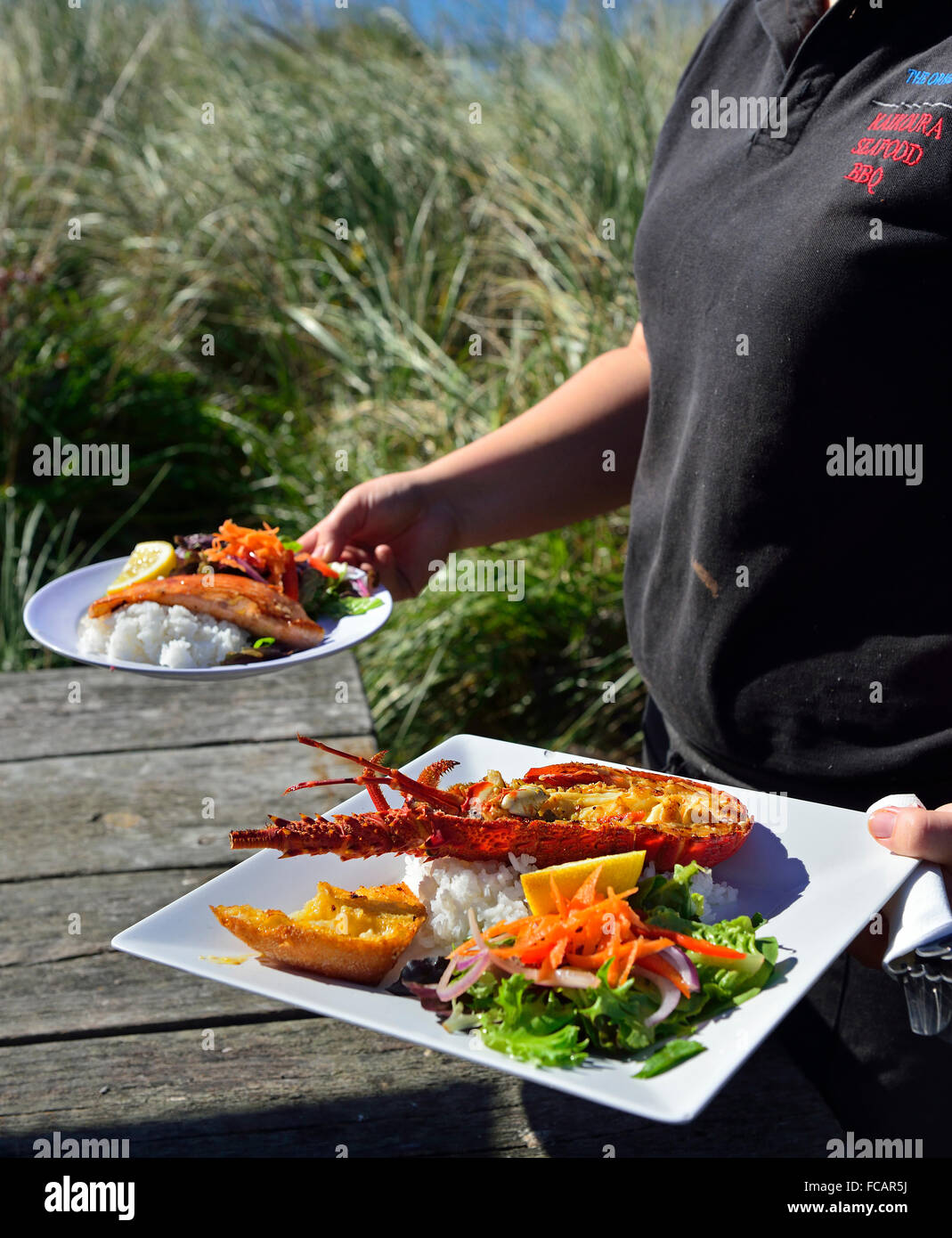 Crayfish meal served  to a road side table from Kaikoura Seafood BBQ Kiosk, Kaikoura. South Island New Zealand - Stock Image