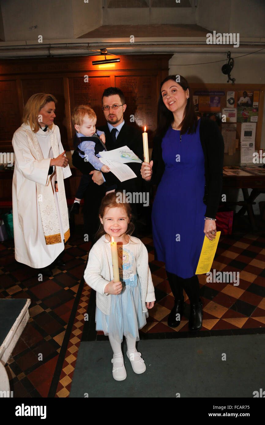 Christening At St Mary's Church Caterham On The Hill Surrey England Family With Female Priest After Christening - Stock Image