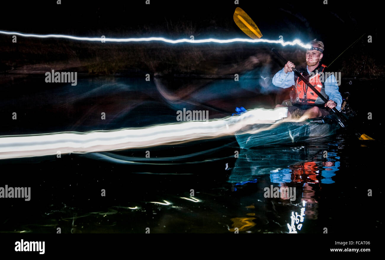 Paddling at night with headlamps - Stock Image