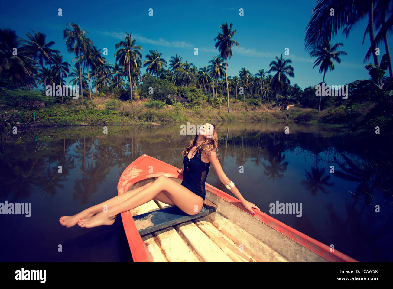 woman posing on boat - Stock Image