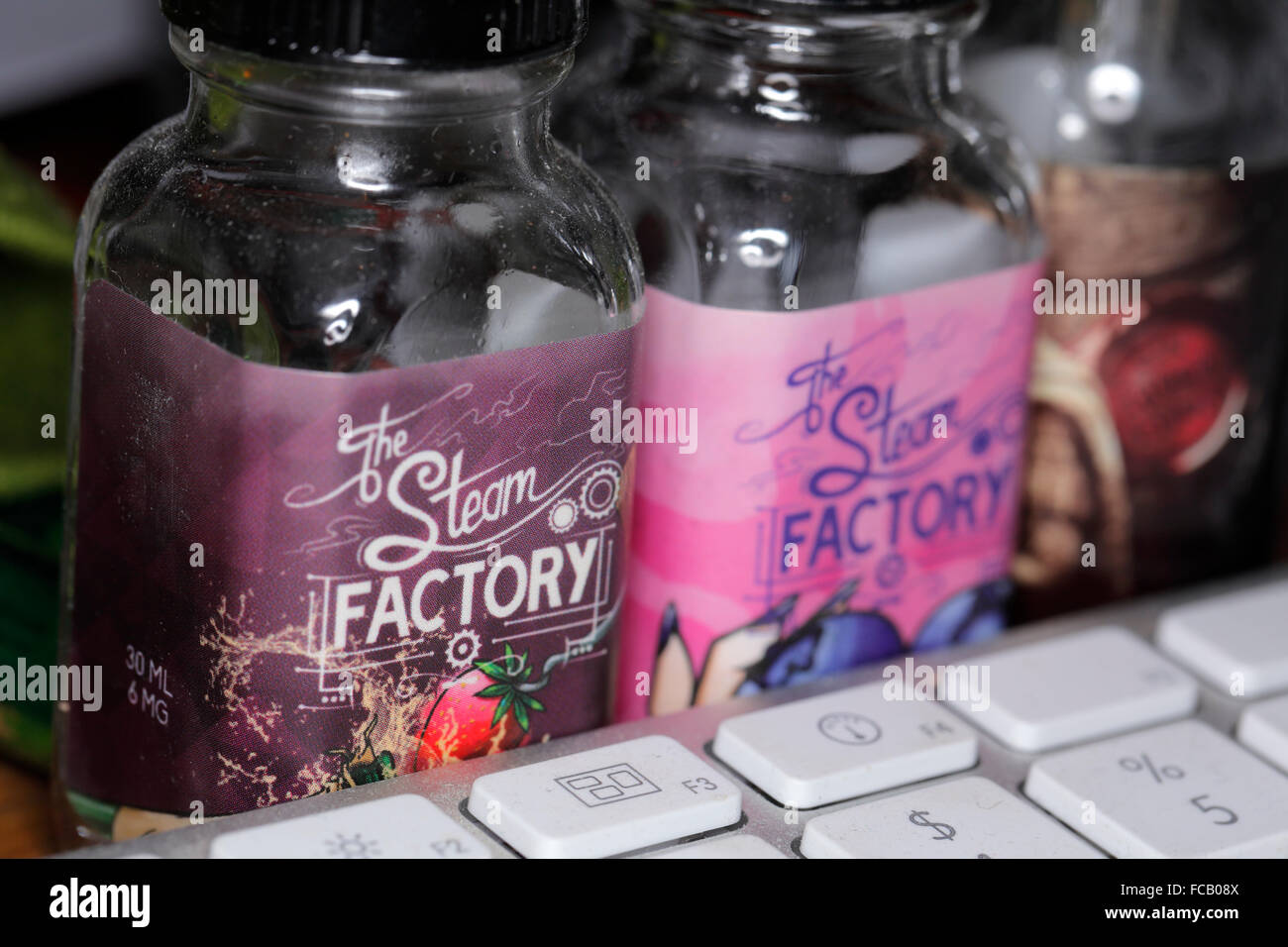 The Steam Factory e-juice bottles. - Stock Image