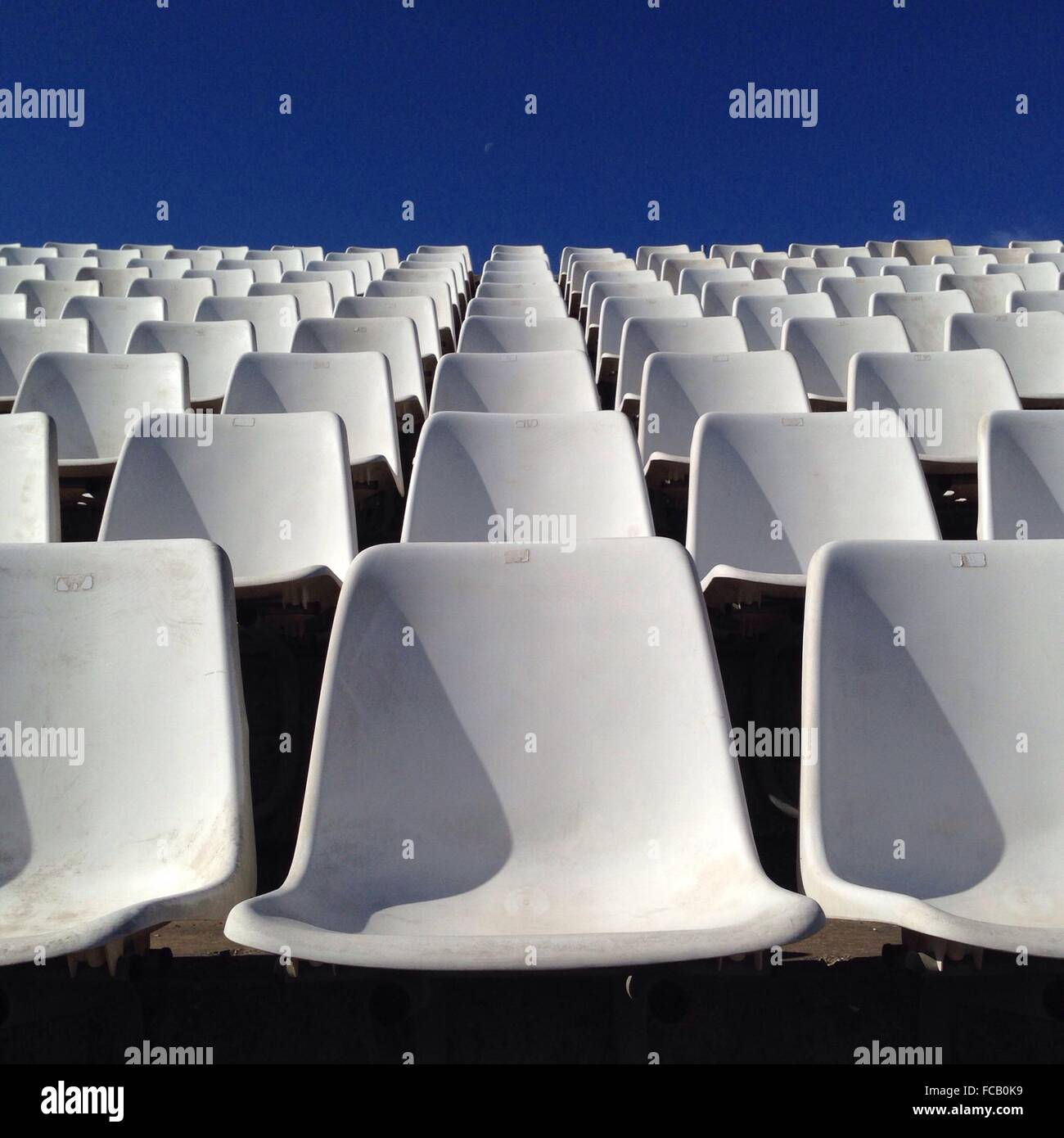 Rows Of Empty White Chairs - Stock Image