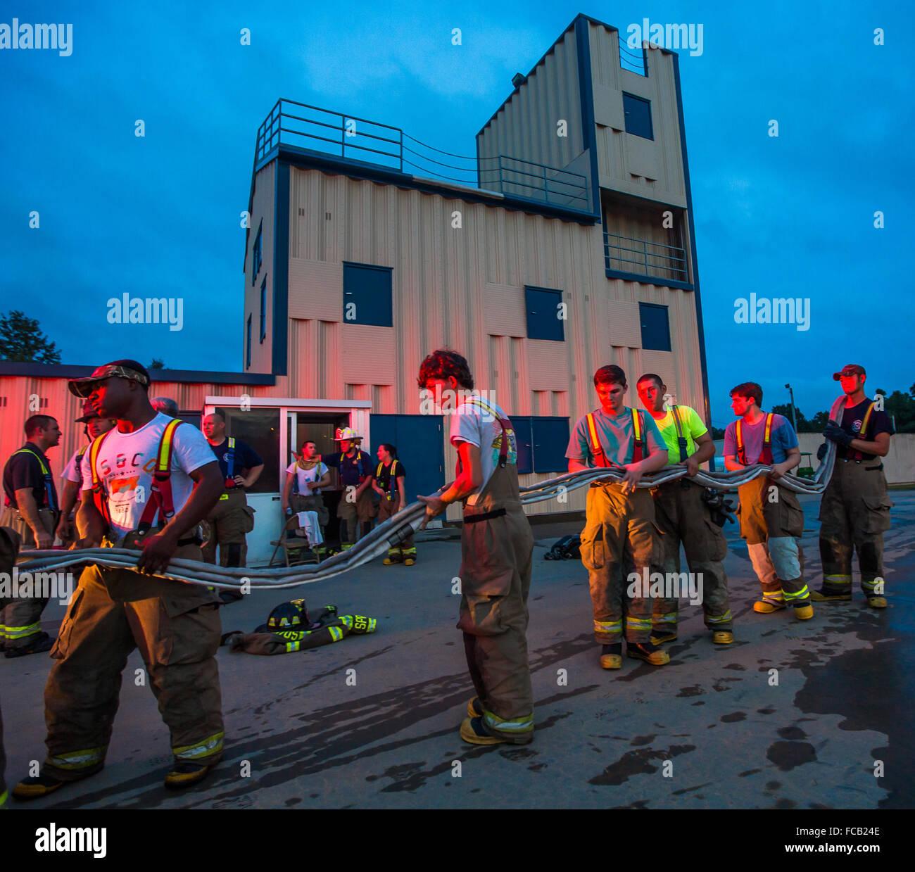 Volunteer firemen training. - Stock Image