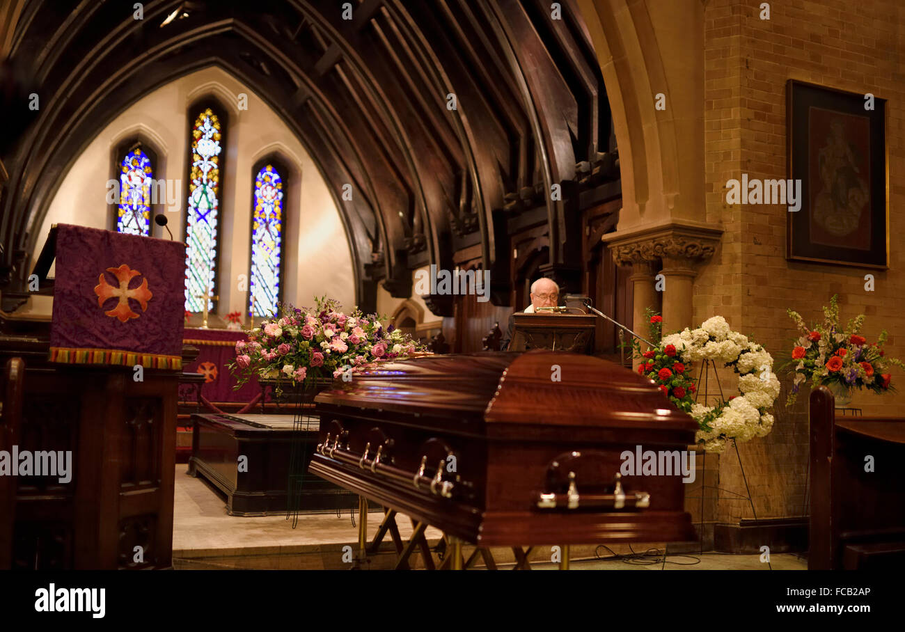 Coffin and flowers at a funeral in a Christian Chapel - Stock Image