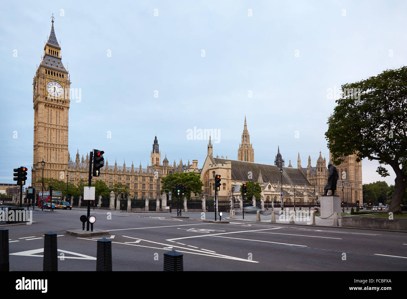 Big Ben and Houses of Parliament in the early morning, empty street in London - Stock Image