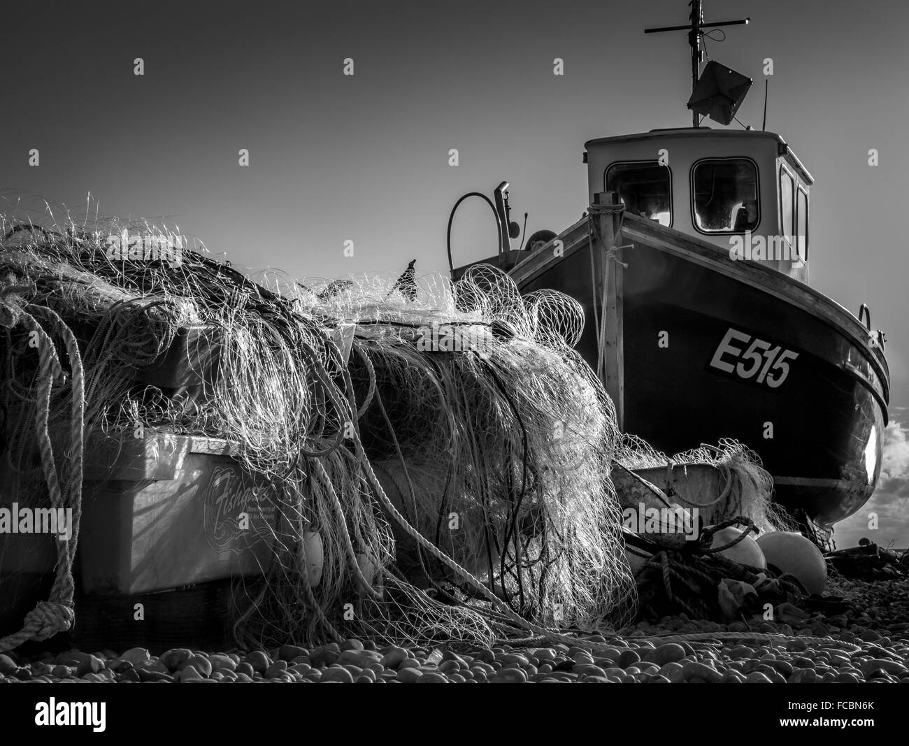 fishing jumble and boat on beer beach - Stock Image